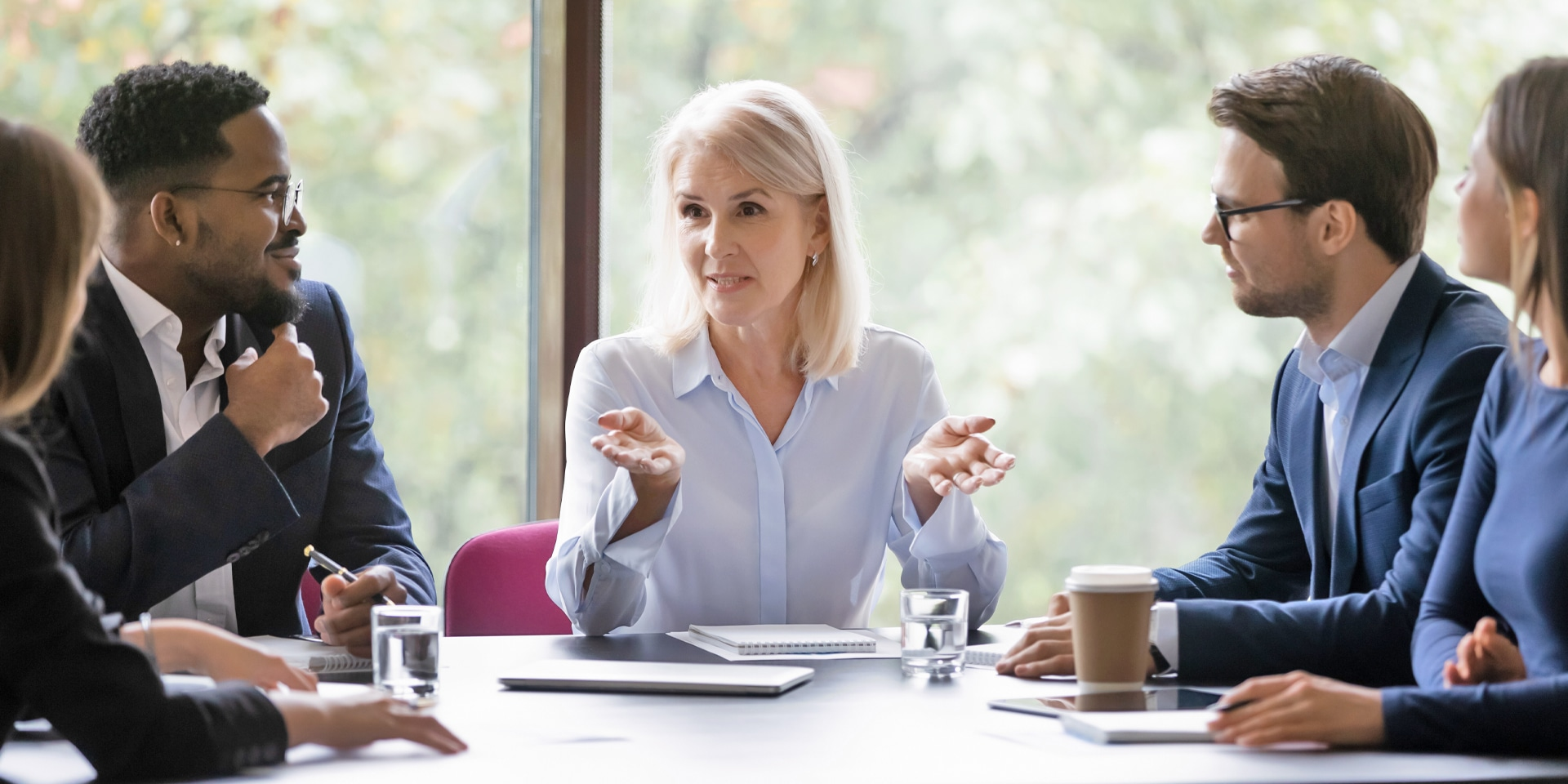 Woman in a meeting with her team