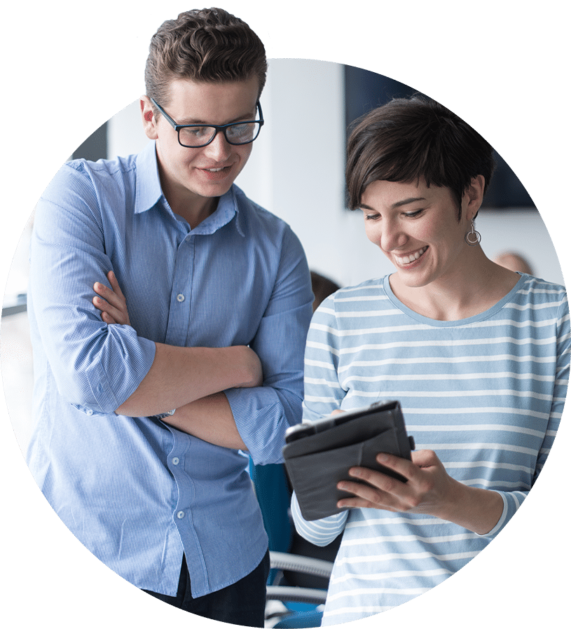 Man and women looking at tablet