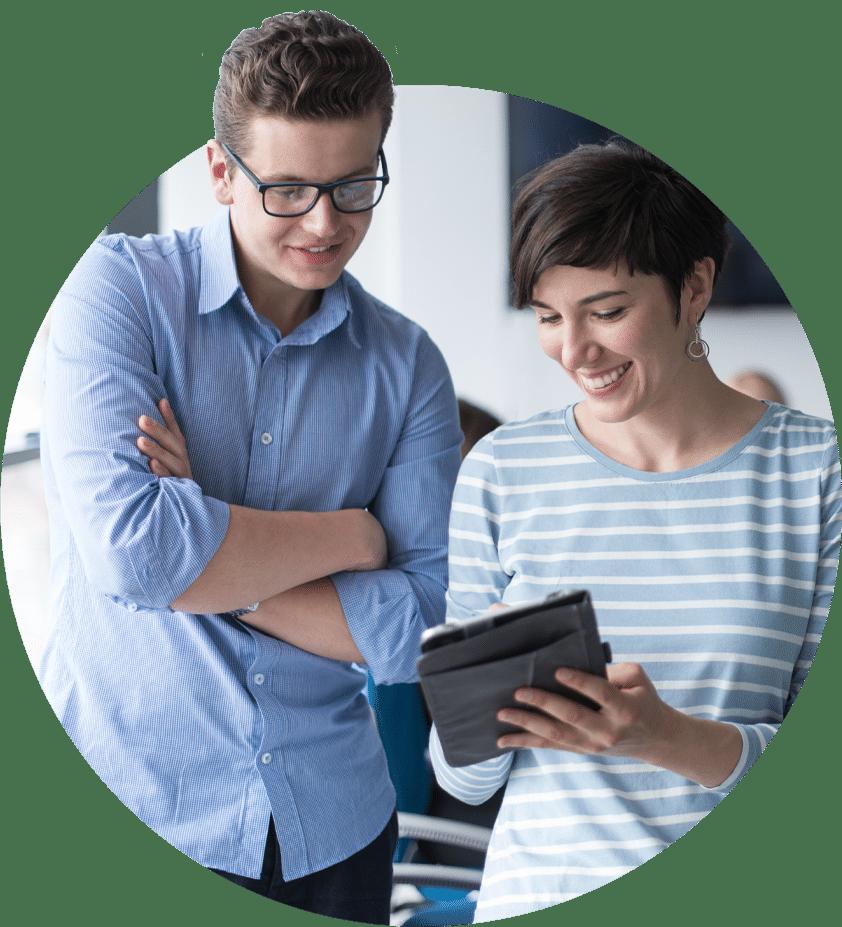 Man and Woman looking at tablet