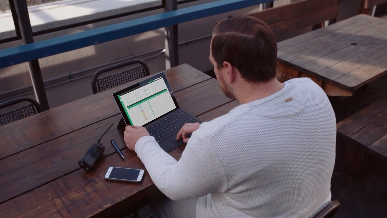Manager using roubler app on laptop