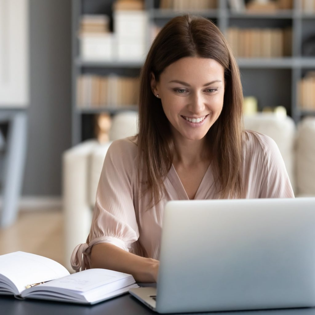 woman working on laptop in home office