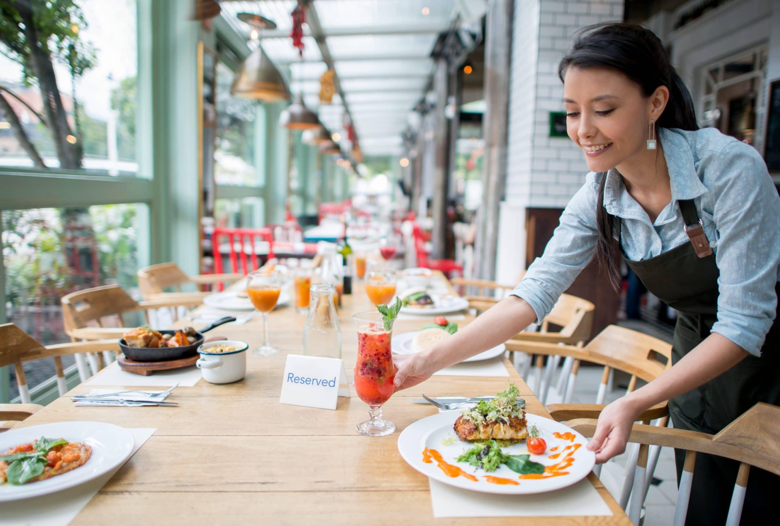Waitress serving dinner at a restaurant