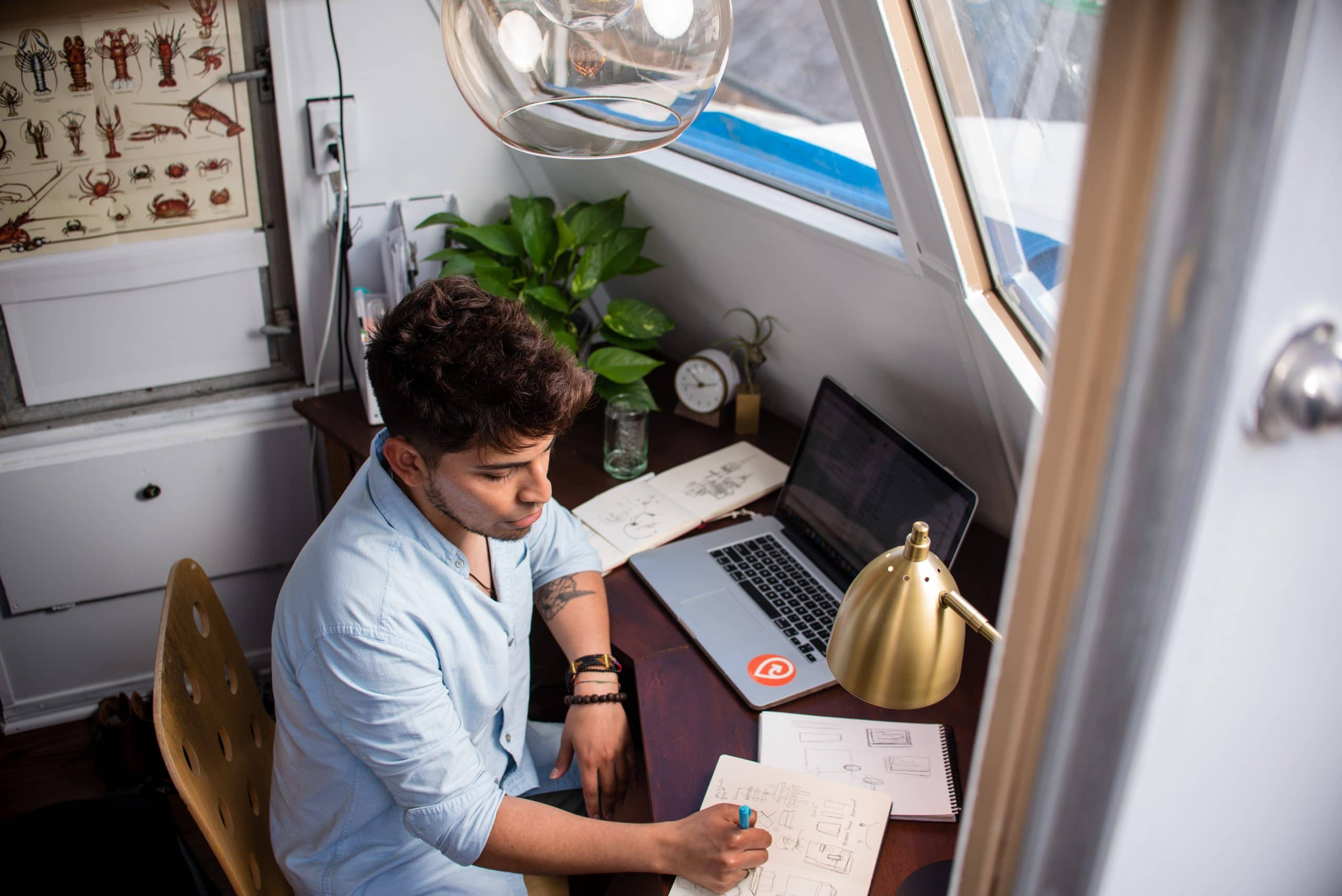 Casual business person working at desk and computer
