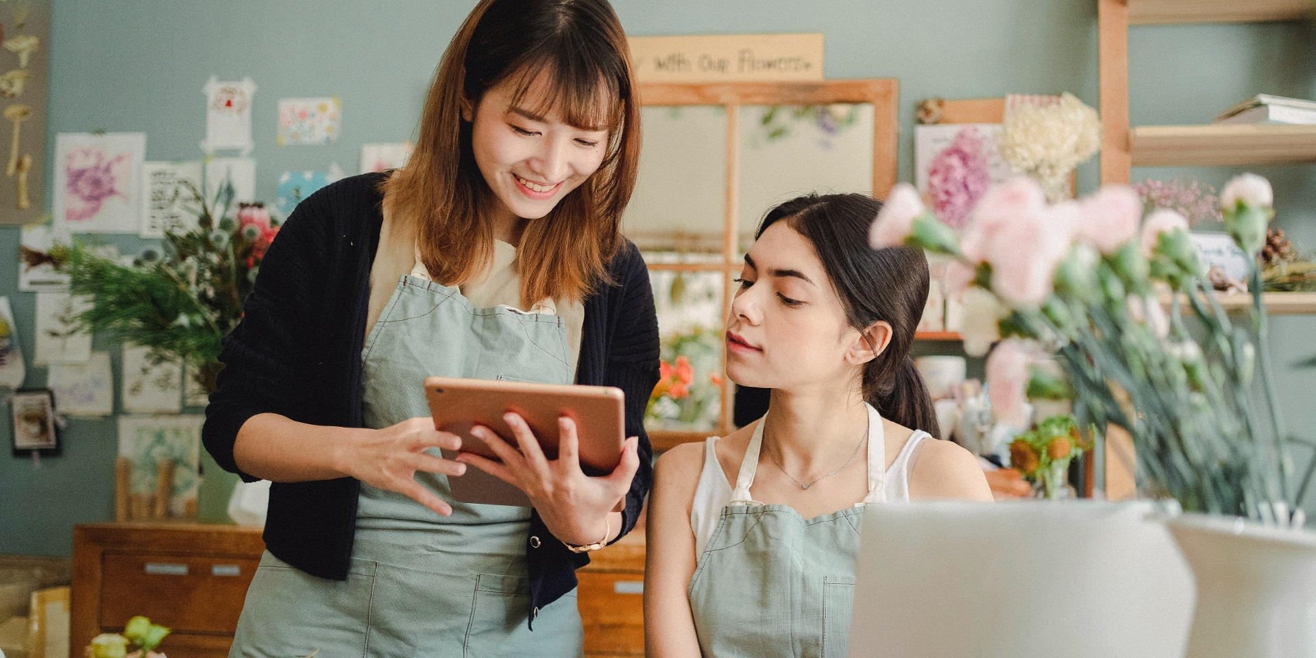 singapore women using tablet in their business