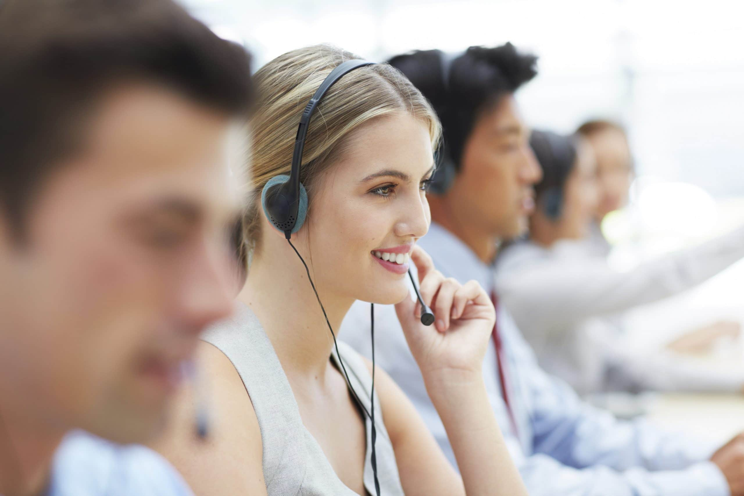 Cropped shot of telecommunications workers sitting at their desks