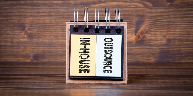 Deciding whether to keep payroll in-house or outsource it.