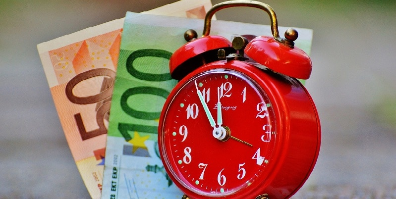 Clock and money denoting time theft