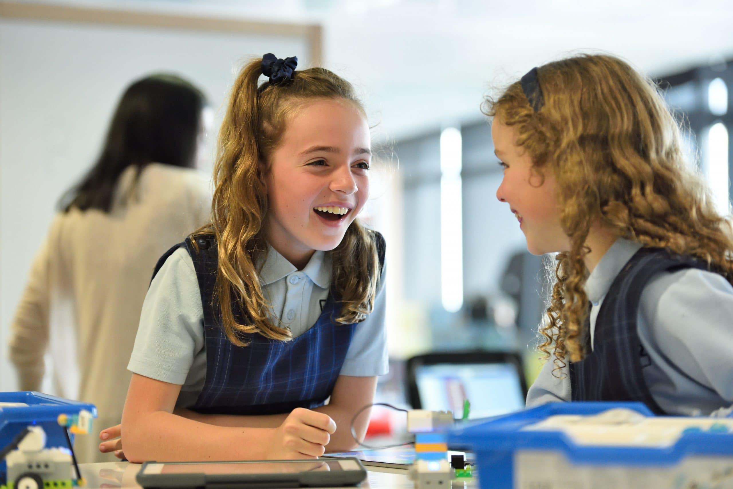 Schoolgirls chatting in classroom