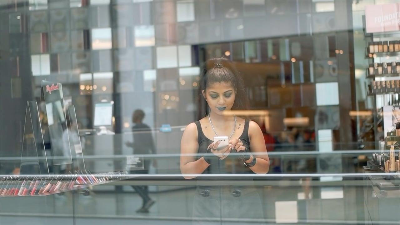 Women using roubler app through window